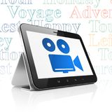Travel concept: Tablet Computer with Camera on display. Travel concept: Tablet Computer with  blue Camera icon on display,  Tag Cloud background, 3D rendering Royalty Free Stock Image