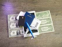 Travel concept with tablet, credit cards and flight tickets on dark table.  Royalty Free Stock Photo