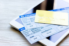 Travel concept with tablet, credit cards and flight tickets on light table. Travel concept with tablet, credit cards and flight tickets on light wooden table Royalty Free Stock Photo