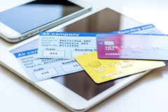 Travel concept with tablet, credit cards and flight tickets on light table. Travel concept with tablet, credit cards and flight tickets on light wooden table Royalty Free Stock Images