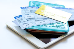 Travel concept with tablet, credit cards and flight tickets on light table. Travel concept with tablet, credit cards and flight tickets on light wooden table Stock Images