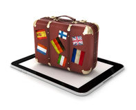 Travel Concept with tablet and suitcase Royalty Free Stock Photos