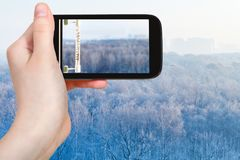 Tourist photographs thermometer in cold winter day. Travel concept - tourist photographs outdoor thermometer in cold winter day in Moscow city on smartphone Royalty Free Stock Photography