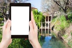 Tourist photographs park Giardini Salvi in Vicenza. Travel concept - tourist photographs public park Giardini Salvi (Garden of Valmarana Salvi) with Valmarana Royalty Free Stock Photo