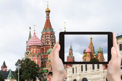 Tourist photographs St Basil Cathedral in Moscow Royalty Free Stock Photos