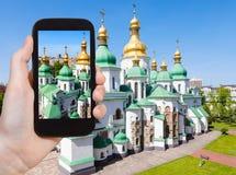 Tourist photographs Saint Sophia Cathedral. Travel concept - tourist photographs Saint Sophia (Holy Sophia, Hagia Sophia) Cathedral in Kiev city in Ukraine on Royalty Free Stock Photos