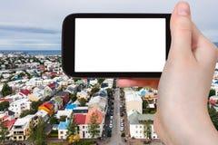 Tourist photographs street in Reykjavik city Stock Image