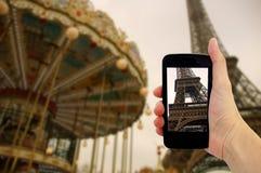 Travel concept - tourist taking photo of Eiffel tower in Paris.  stock photos