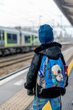 Travel concept of two boys on train station platform Royalty Free Stock Photos