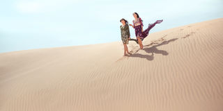 Travel concept. Two gordeous women sisters traveling in desert. stock photography