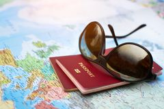 Travel concept, two passports on the map of the world, holidays stock images