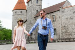 Travel concept - two tourists in love walking in old town. Of Tallinn, Estonia Stock Photo