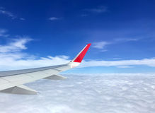 Travel concept, view of clouds from the window airplane with mor Stock Images