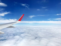 Travel concept, view of clouds from the window airplane with mor Stock Photo