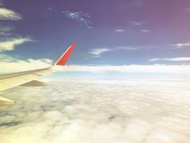Travel concept, view of clouds from the window airplane with mor Royalty Free Stock Photo
