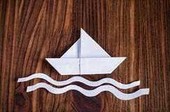 Travel concept with a white paper boat Stock Photos