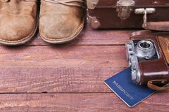 Free Travel Concept With Vintage Suitcase, Sunglasses, Old Camera, Suede Boots, Case For Money And Passport On Wooden Floor. Stock Images - 107359974