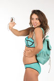 Travel concept. Woman doing selfie with old camera. Isolated on Royalty Free Stock Photo