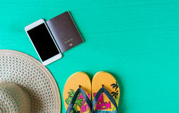 Travel concept. Women Panama hat, passport, smartphone flat lay on green background with copy space Stock Photos