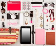 tablet pc, camera, passport, straw bag, notepads, sunglasses, watch, headphones, pills, cosmetics makeup and essentials on white w stock photography