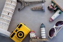 Travel concept with world famous souvenir Stock Images