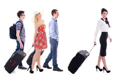 Travel concept - young beautiful stewardess and tourists with su stock photography