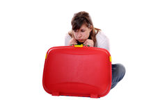 Travel concept young bored woman with suitcase Stock Photography