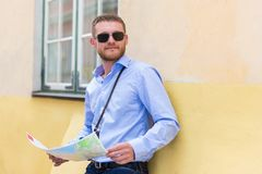 Travel concept - young man tourist with city map Royalty Free Stock Photo