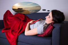 Travel concept - young woman sleeping and dreaming about vacatio Royalty Free Stock Photography