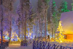 Travel Concepts and Ideas. Marvelous Lapland Houses in Suomi Village. In Front of Marvelous Highlighted Winter Forest Scenery.Horizontal Image composition Royalty Free Stock Photography