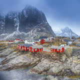 Travel Concepts and Ideas. Traditional Fishing Hut Village in Hamnoy Mountain Peak in Lofoten Islands, Royalty Free Stock Photography