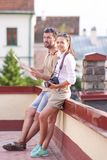 Travel Concepts. Young Caucasian Couple Travelling Through the city Royalty Free Stock Photography