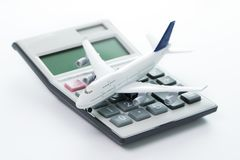 Travel cost, budget or expenses. Miniature airplane model with calculator for travel budget, cost or expenses concept Royalty Free Stock Photos