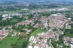 Travel Costa Rica. San Jose, Costa Rica - May 24 : aerial view of the city of Alajuela from the interior of a small plane. May 24 2016, San Jose Costa Rica Stock Photos
