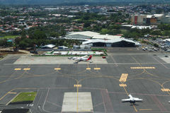 Travel Costa Rica. San Jose, Costa Rica - May 24 : aerial view of a maintenance and waiting area of the  International airport from the inside of a small plane Stock Images