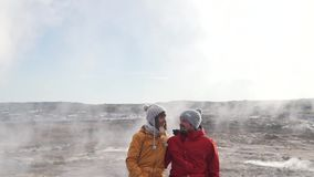 Travel couple on the background of geysers.  stock video