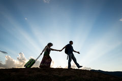 Travel couple beautiful sunset. Man and women travel silhouette beautiful sky background stock photo