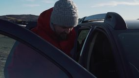 Travel couple get into the car.  stock video footage