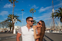 Travel couple happy in Barcelona. Romantic couple walking outdoors in old harbor, Port Vell in Barcelona Catalonia, Spain. Stylish young men and women on travel stock images