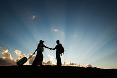 Travel couple meeting. Man and women travel on sunset blue sky dusk stock photos