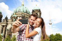 Travel couple selife self portrait, Berlin Germany. Travel couple selife self portrait, Berlin, Germany. Happy tourists people in front of Berlin Cathedral / Royalty Free Stock Photography