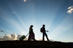 Travel couple silhouette. Man and women travel on sunset blue sky dusk royalty free stock photo