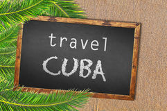 Travel Cuba palm trees and blackboard on sandy beach Royalty Free Stock Photos