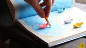 Travel deals concept. Travel and tourism concept, , paper boats on the map stock video footage