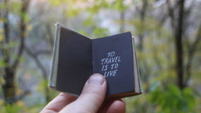 Travel deals idea. Hand holding a book with text stock video
