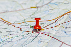Travel destination. Red pin in a map with great colors Royalty Free Stock Images