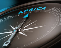 Travel destination - Africa. Abstract compass needle pointing the destination africa, blue and brown tones with focus on the main word. Concept image suitable royalty free illustration