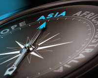 Travel destination - Asia. Abstract compass needle pointing the destination asia, blue and brown tones with focus on the main word. Concept image suitable for stock illustration