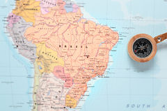 Travel destination Brazil, map with compass. Compass on a map pointing at Brazil and planning a travel destination Stock Photo