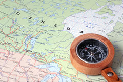 Travel destination Canada, map with compass. Compass on a map pointing at Canada and planning a travel destination Royalty Free Stock Image